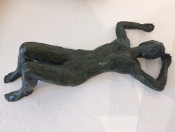 Figure lying on her back Sculpture