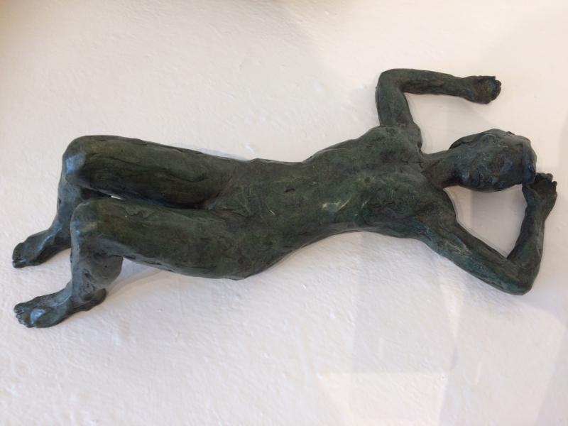Figure lying on her back